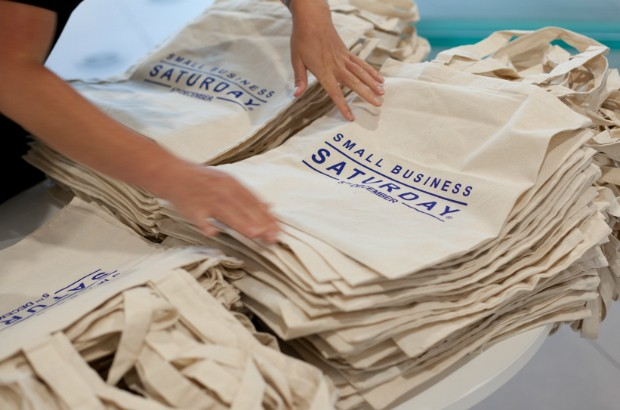 A pile of Small Business Saturday promotional bags.
