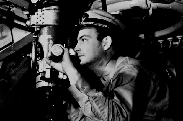 Officer at periscope in control room of a U.S. Navy submarine in World War II. (Public Domain)