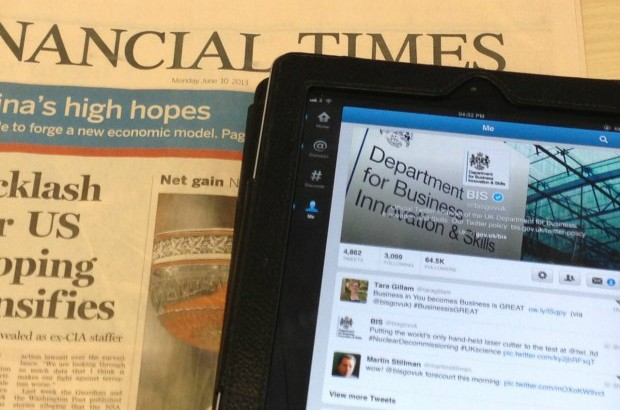 An iPad laying on a copy of the Financial Times.