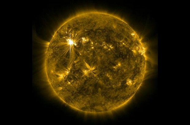Image of the sun from space with a solar flare.