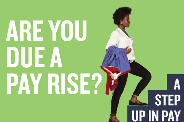 "Detail from the National Minimum Wage campaign. Shop worker holding dresses climbing stairs. Text says: ""Are you due a pay rise? A step up in pay."""